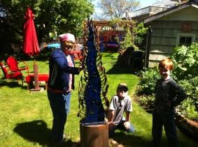 Cheryl Garcia in her Art Garden with my boys