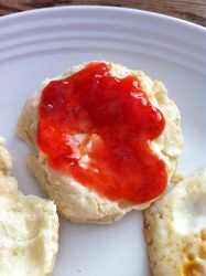 Delicious Strawberry Jam on homemade biscuits. Such a Sunny, Bright Taste!